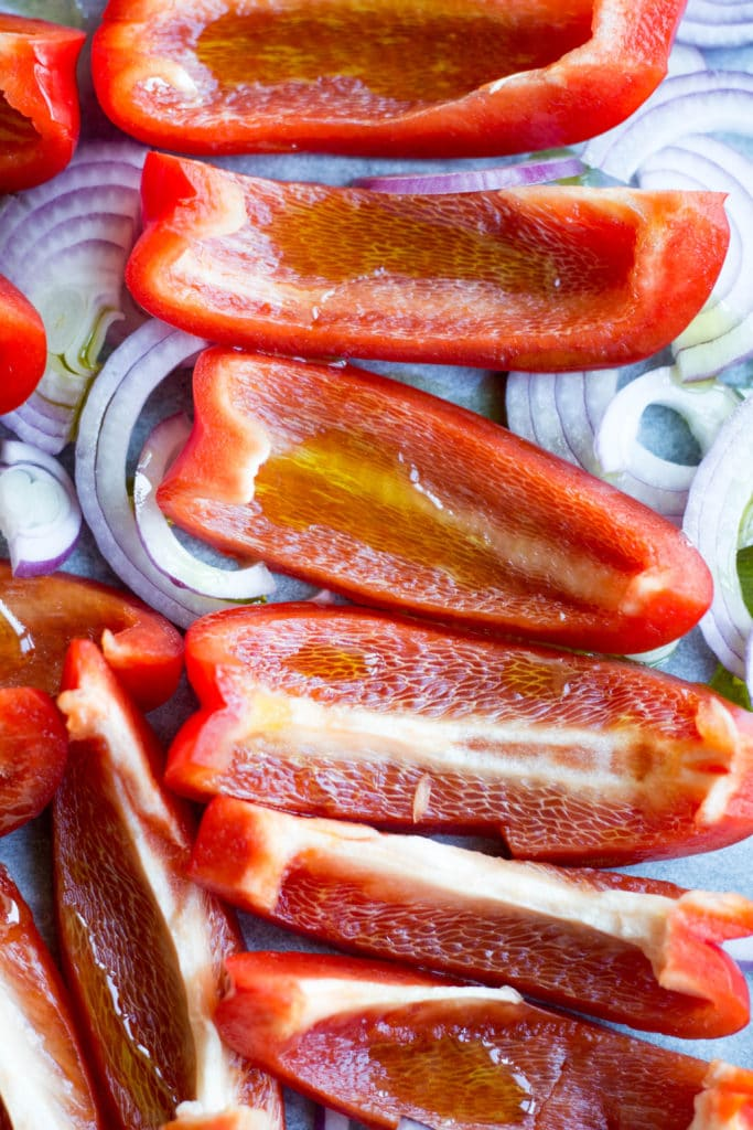 Red peppers and red onion with olive oil