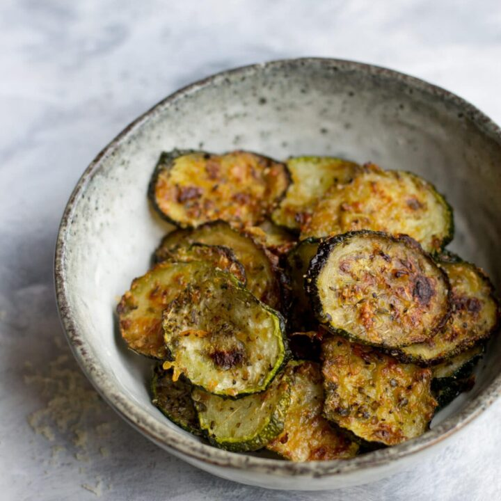 Baked keto courgette chips in a bowl