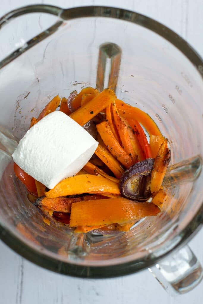 Ingredients for keto roasted vegetable soup in a blender