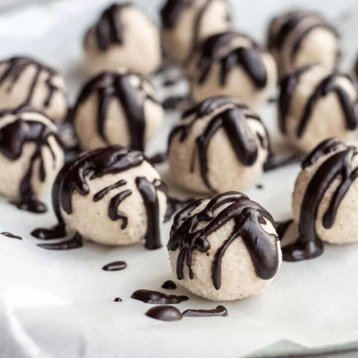 Coconut truffles with melted chocolate