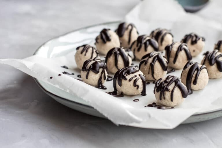 Keto coconut truffles with melted chocolate