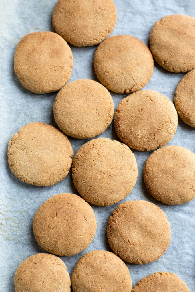Cooked peanut butter cookies on a baking tray