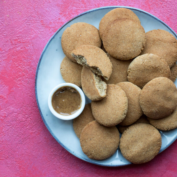 Keto peanut butter cookies and peanut butter in a bowl