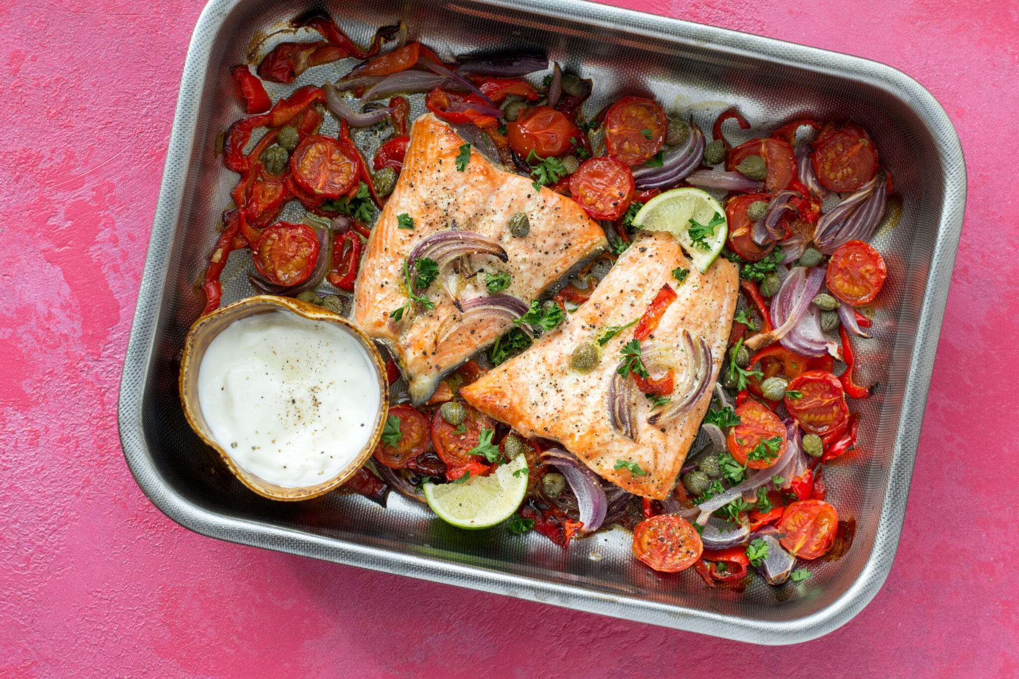 Salmon and vegetables cooked in a baking tray