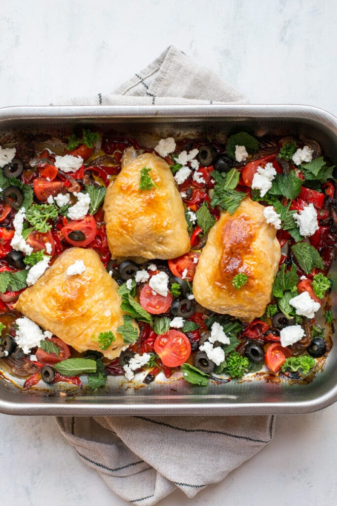 Keto Greek chicken one-tray dinner with olives and fresh herbs