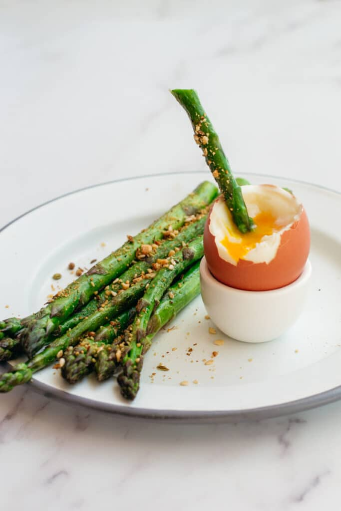 Asparagus dipped in a soft boiled egg