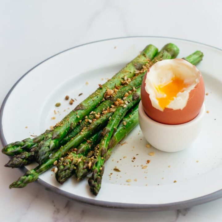 Keto breakfast with asparagus and soft boiled eggs