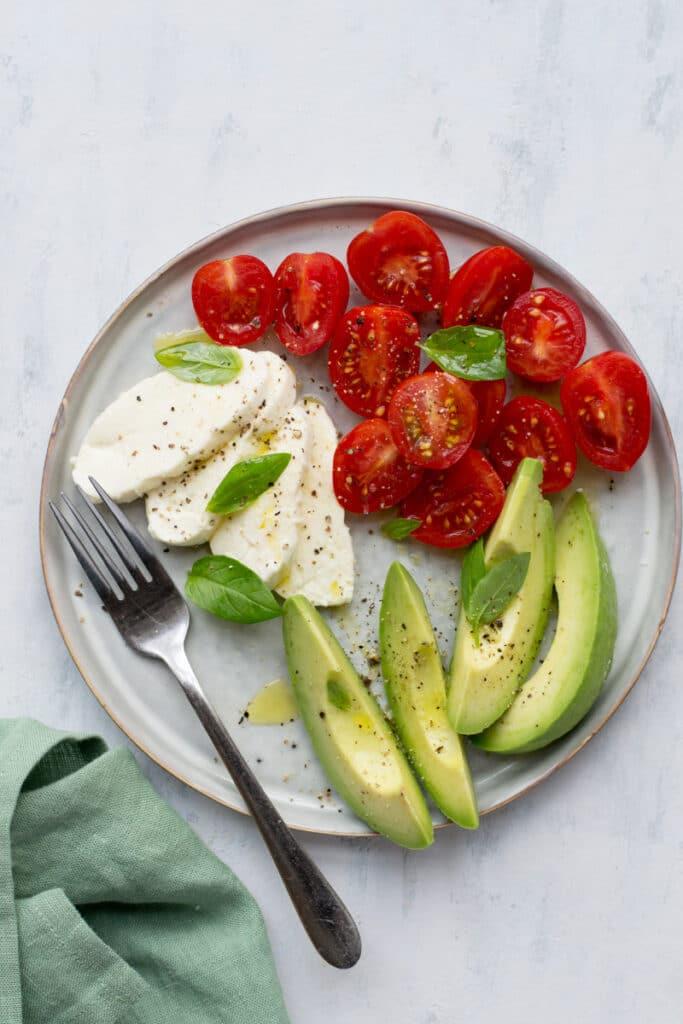 Vegetarian keto Caprese salad with avocado