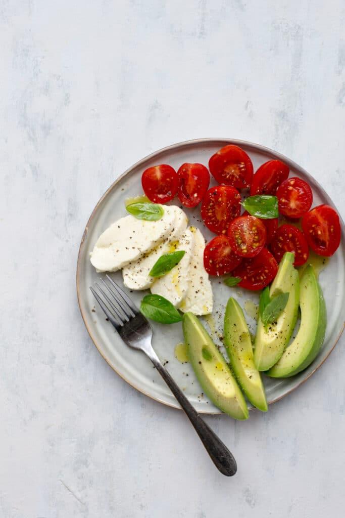 Mozzarella, tomatoes and avocado on a plate